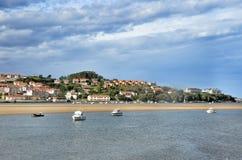 Landscape and white yacht in San Vicente de la Barquera city Spain Stock Photos