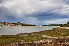 Landscape and white yacht in San Vicente de la Barquera city Spain Royalty Free Stock Photography