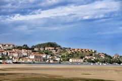 Landscape and white yacht in San Vicente de la Barquera city Spain Royalty Free Stock Photos