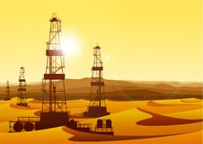 Landscape whith oil rigs in barren desert royalty free illustration