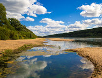 Landscape on a wide river ending with swamps with sandy shoals and shores Royalty Free Stock Image