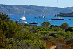 Landscape of wild nature with some yachts moored in the middle of the sea. Of Caprera Stock Photography
