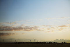 Landscape of a wind farm at sunset Stock Photo