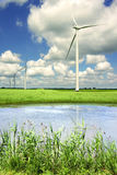 Landscape with wind generator and lake stock images
