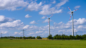 Landscape with wind generators and electrical tower Royalty Free Stock Photography
