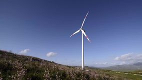 Landscape with wind mill stock video footage