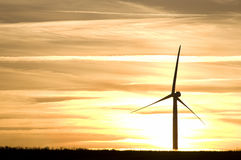 Landscape with wind turbine. Silhouettes of wind turbines on sunset sky background Stock Photo
