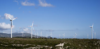 Landscape with wind turbine. Wind turbine to generate electricity symbol of renewable energy Royalty Free Stock Image