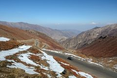 Landscape of the winding highway on Babusar road with a view of mountain range. Khyber Pakhtunkhwa, Pakistan royalty free stock photos