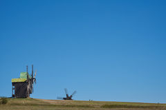 Landscape with windmills on the background of blue sky. Backgrou Stock Photos