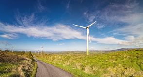 Landscape with windmills on a blue  sky in a county Cork Royalty Free Stock Images
