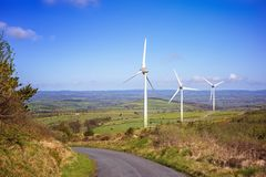 Landscape with windmills on a blue  sky in a county Cork Royalty Free Stock Photo