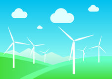 Landscape with windmills. On field background and mountains Royalty Free Stock Image