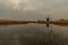 Landscape with windmills. A landscape with water and windmills Stock Photography