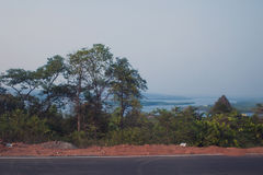 Landscape from the window of the car. Lakes, forests and sky in the evening. India Royalty Free Stock Photos