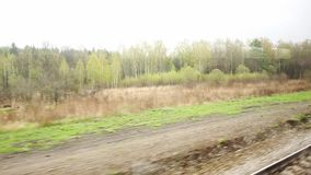 Landscape from the window of a moving train stock footage