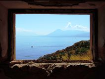 Landscape in a window of the old house Royalty Free Stock Image