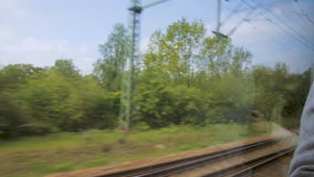 Landscape from window view of a moving train in Germany.  stock footage