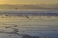 Landscape of winter ocean with ship on Kamchatka. Stock Images
