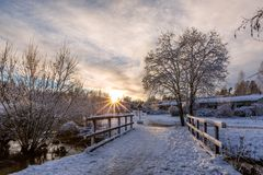 Landscape of winter park with bridge on foreground Royalty Free Stock Photos