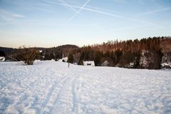 Landscape winter with some houses. Beauty winter landscape in harz germany royalty free stock photo