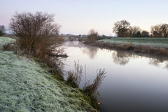 Landscape Winter surnise of river and frosty fields Stock Photos