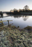 Landscape Winter surnise of river and frosty fields Stock Images