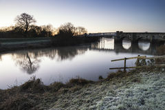 Landscape Winter surnise of river and frosty fields Royalty Free Stock Images