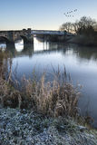 Landscape Winter surnise of river and frosty fields Stock Photography