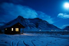 Free Landscape With A Wooden House With Light From The Window In A Winter Night.  Scenic View Of Moonlight On The Snow With Mountains I Stock Photo - 166655690