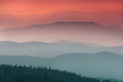 Free Landscape With Colorful Layers Of Mountains And Haze  Hills Covered By Forest. Stock Photography - 80831452
