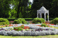 Landscape With Flower Beds And A Gazebo Royalty Free Stock Photos