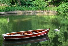 Free Landscape With Old Row Boat And Swan On Lake In Forest In Summer Royalty Free Stock Photos - 194153188