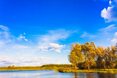Landscape With River And Blue Sky Stock Photos