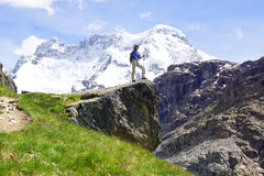 Landscape with with  woman with backpack., Switzerland. Royalty Free Stock Images