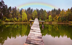 Landscape on the wood lake with rainbow Royalty Free Stock Photography