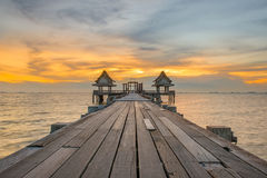 Landscape of Wooded bridge pier between sunset. Summer travel in Royalty Free Stock Photo
