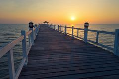 Landscape of Wooded bridge in the port between sunset. stock photo