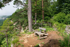 Landscape with wooden bench at cliff Stock Photo