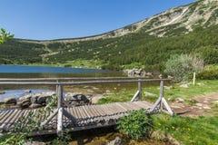 Landscape with wooden bridge over river in Pirin Mountain near Bezbog lake Stock Photo