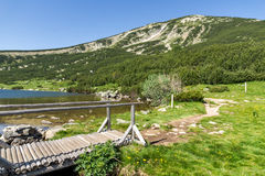 Landscape with wooden bridge over river in Pirin Mountain near Bezbog lake Stock Images