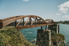 Landscape with a wooden bridge over the sea in ribadeo, spain. Landscape with a wooden bridge over the sea in ribadeo, lugo, spain royalty free stock image