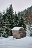 Wooden cabin in the winter Stock Image