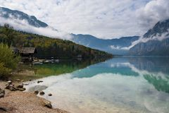 Wooden cabin at the border of Bohinj Lake in autumn Royalty Free Stock Photography