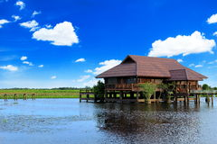 Landscape of wooden house in a lake and blue sky background, Tha Royalty Free Stock Image