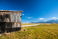 Landscape and wooden house Royalty Free Stock Photography