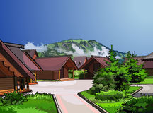 Landscape wooden houses on a background of mountains. In summer Stock Photography