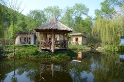 Landscape with wooden houses, pavilion and lake Stock Photo