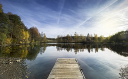Landscape with Wooden Pier on Lake. ace. South Bohemia, Czech Republic, Euro. Landscape with Wooden Pier on Lake. Autumn Evening Pond with Trees Reflected on stock photos