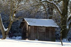 Landscape with wooden shack Stock Photography